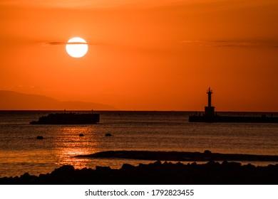 Autumn, sunset and twilight beach