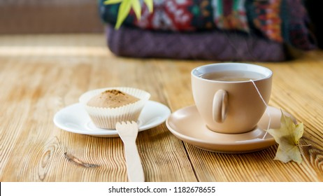 Autumn tea in warm  colors with piles of  knitted sweater behind
