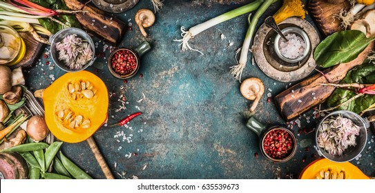 Autumn Thanksgiving seasonal cooking with harvest vegetables , Pumpkin , Mushrooms and Other  seasonal cooking ingredients on rustic kitchen table background, top view, frame , banner