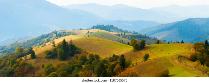 Autumn tranquil landscape. Autumn hills with most. Colorful fall valley. Autumnal background.