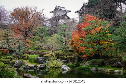 Autumn trees at the garden with ancient castle in Kanazawa, Japan.