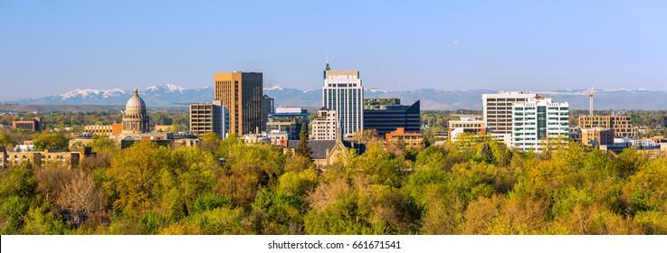 Autumn trees surround the city skyline of Boise Idaho