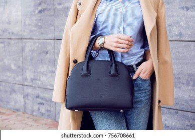 Autumn trendy outfit woman in stylish beige coat and jeans with black big bag - Shutterstock ID 756708661