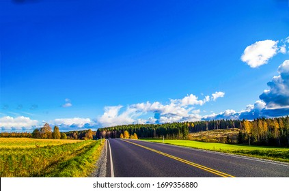 Autumn valley highway road landscape. Highway road in autumn season. Autumn highway road landscape. Autumn highway road