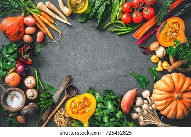 Autumn vegetables ingredients for tasty Thanksgiving or Christmas dishes on rustic kitchen table. Top view