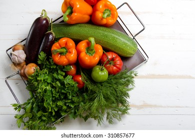 Autumn vegetables: zucchini, aubergines, bell peppers, tomatoes, onions, garlic, parsley and dill