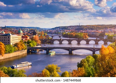 Autumn view to Charles bridge on Vltava river in Prague, Czech Republic. Autumn view to Charles Bridge, Prague old town and Vltava river from popular view point in the Letna park (Letenske sady). - Shutterstock ID 1487449868
