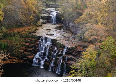 Autumn view of Corra Linn waterfall on the River Clyde near New Lanark, Scotland, UK.