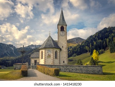 Autumn view with dramatic clouds on Small chapel in tiny village near Lake Braies Park (Lago di Braies). South Tyrol. Italy. Europe