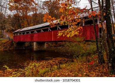 An autumn view of the historic Lower Humbert Kingpost truss covered bridge in Somerset County, Pennsylvania.