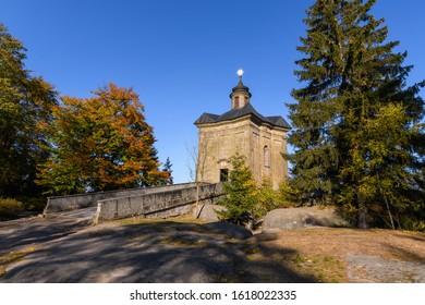 Autumn view of Hvezda church in Broumovske steny,  Adrspach rocks,  Czech republic - Shutterstock ID 1618022335