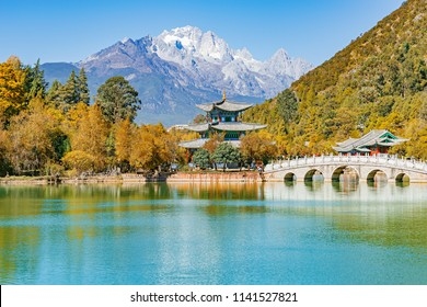 Autumn view of the Jade Dragon Snow Mountain and the Black Dragon Pool. Yunnan province. Lijiang. China.