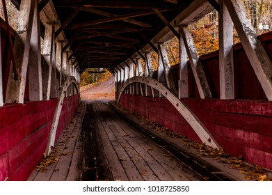 An autumn view of the Lower Humbert covered Kingpost through truss bridge in Somerset County, Pennsylvania.