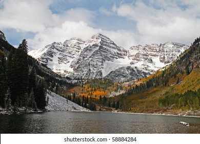 An autumn view of the Maroon Bells with Maroon Lake in the foreground
