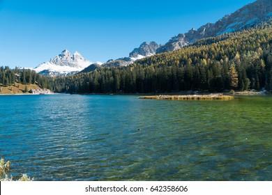 Autumn View of Misurina Lake with Tre Cime di Lavaredo mountains in the background, Dolomites, South Tyrol, Italy