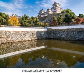 Autumn view of the most famous and visited castle in Japan, Himeji Castle,  considered the prototypical Japanese castle, featuring many elements associated with feudal Japanese castle architecture.