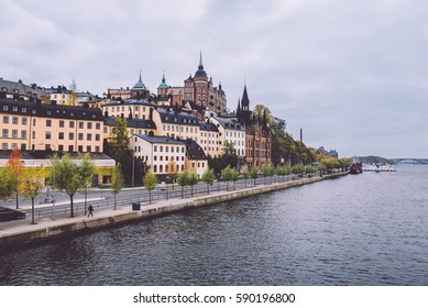 Autumn view of Old Town pier architecture in Sodermalm district in Stockholm, Sweden. Stockholm cityscape with Riddarfjarden marina and Soder Malarstrand embankment.
