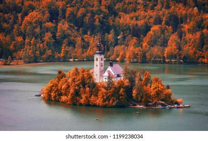 Autumn view on Bled Lake with Pilgrimage Church of the Assumption of Maria. Top view Bled, Slovenia, Europe. Autumn Lake. Lake Bled with small Island during autumn. Bled, Slovenia.