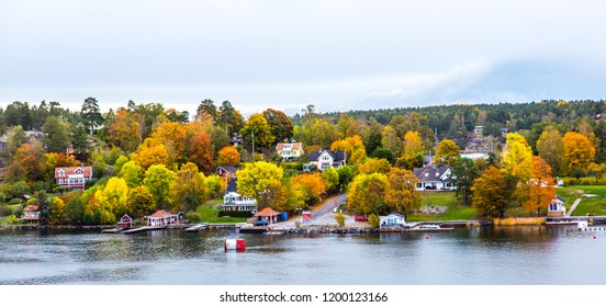 autumn View on luxury cottages on  Stockholm archipelago, Sweden. colorful Autumn view.