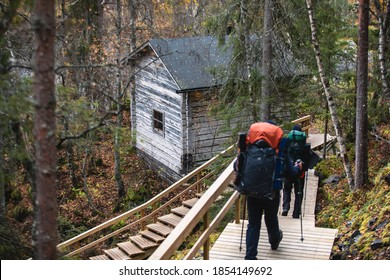 Autumn view of Oulanka National Park, landscape, a finnish national park in the Northern Ostrobothnia and Lapland regions of Finland,  wooden wilderness hut, cabin cottage, bridge, campground place - Shutterstock ID 1854149692