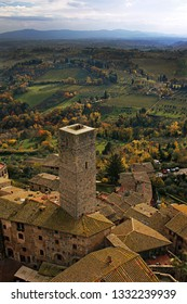 Autumn view over rooftops of San Gimignano to the Tuscan Countryside