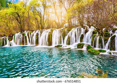Autumn view of the waterfall with pure water at sunrise time. (Jiuzhaigou nature reserve) Jiuzhai Valley National Park, China.