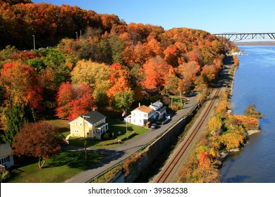 Autumn view of the west bank of the Hudson River and the Poughkeepsie-Highland Railroad Bridge, New York