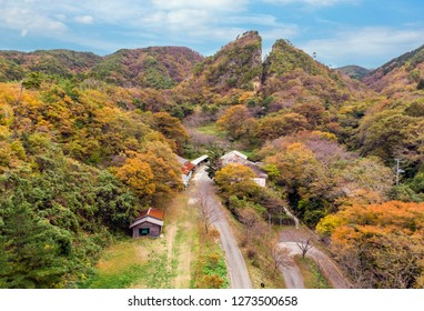 Autumn vivid color at ancients gold and silver mines mountain aerial view, Doyu Tunnel course, Sado