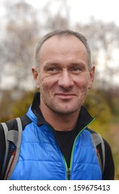 Autumn walk. Close-up portrait of backpackers