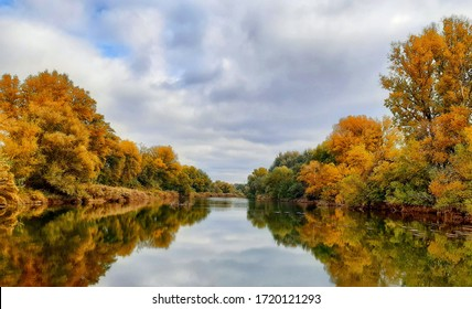 Autumn walk with clouds by the Segre river