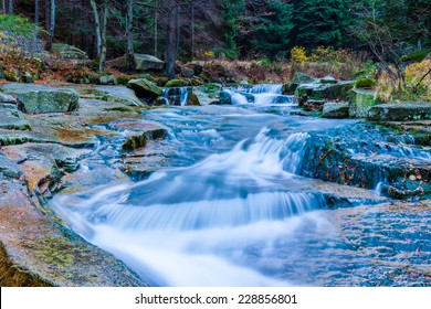 Autumn water cascades in a forest