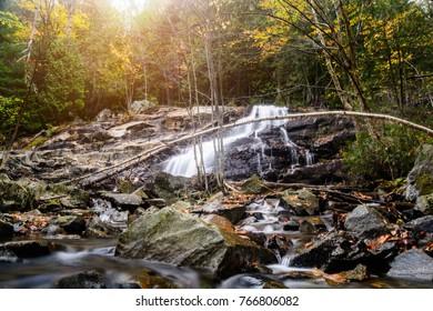 Autumn waterfall at dusk