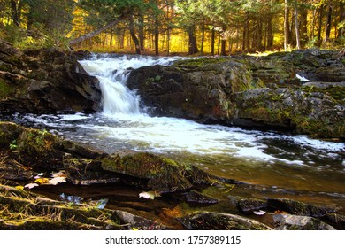 Autumn waterfall with fall foliage on the Falls River in the small town of L'Anse in the Upper Peninsula of Michigan.