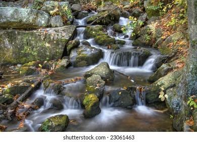 Autumn waterfall scene in the mountains.
