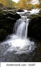 Autumn Waterfall In Scotland Highlands