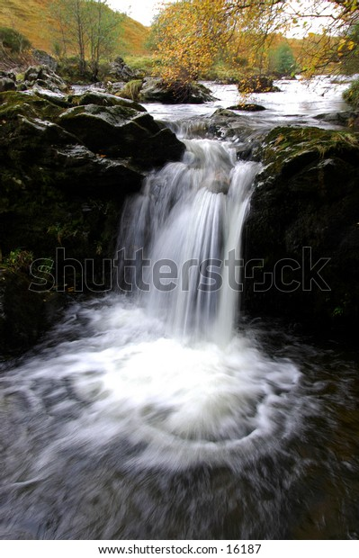 Autumn Waterfall In Scotland Highlands