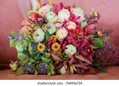 autumn wedding bouquet with berries and pinecones