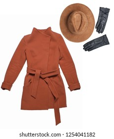 Autumn winter clothing and accessories. Brown women's cashmere coat, felt hat, leather gloves on white background. Top view