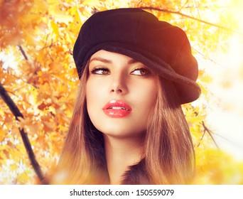 Autumn Woman in a Beret. Hat. Fashion Autumn and Winter Wear. Beauty Girl in Headdress
