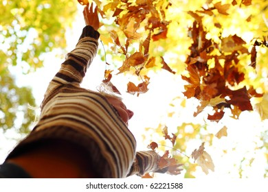 autumn woman drop hands in the air