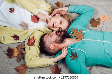 Autumn woman and happy man on Autumn background. Autumn Leaves Festival. Hello Autumn and leaf fall Dreams. I love you very much. Couple in love