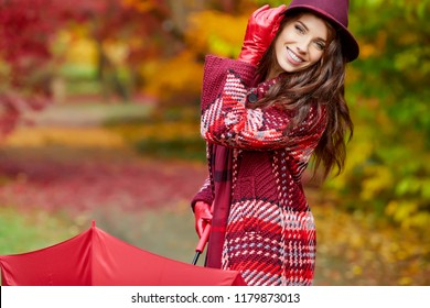 Autumn woman in autumn park , scarf and leather gloves, umbrella