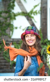Autumn woman wearing orange scarf and hat in autumn colors. motion