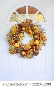 Autumn wreath hanging on a front door,