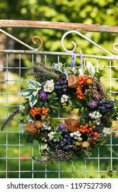 Autumn wreath on a old garden bench