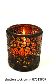 Autumnal candle isolated over white