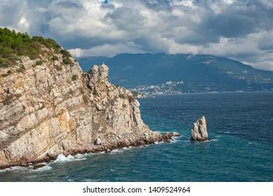 Autumnal Crimean landscape on a Black Sea shore with Sail crag near Yalta city