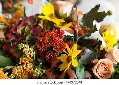 Autumnal flower decoration, mise en place.