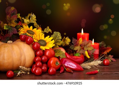 Autumnal fruits and vegetables against  holiday lights.