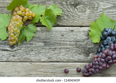 autumnal grapes frame, wooden background